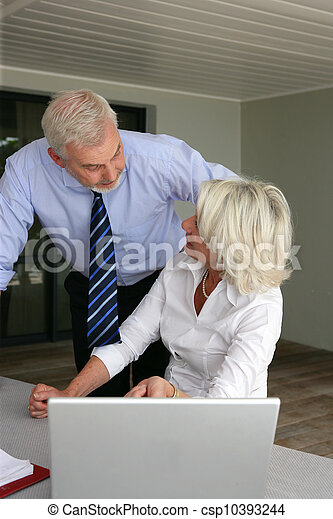Senior couple at a laptop - csp10393244