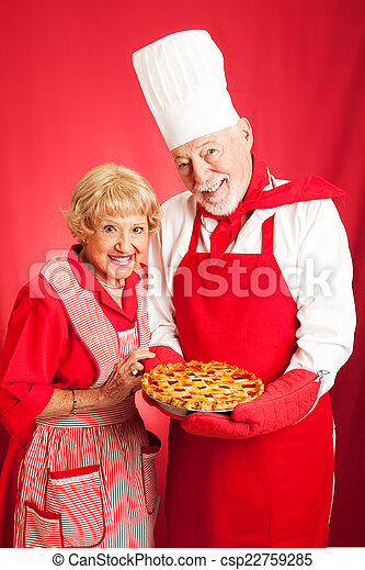 Senior Couple Bakes Together - csp22759285