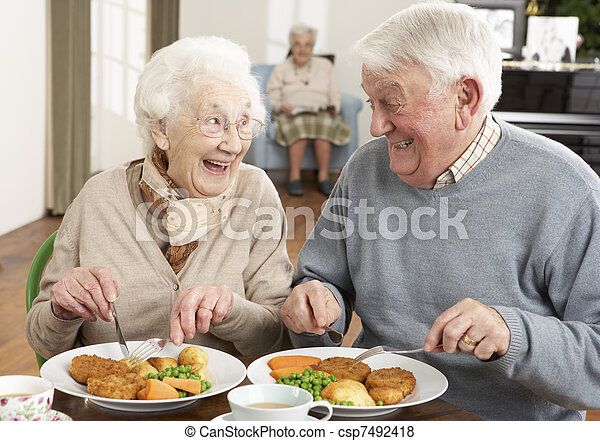 Senior Couple Enjoying Meal Together - csp7492418