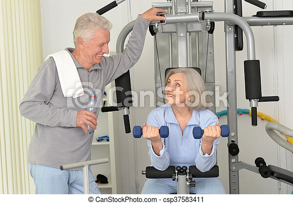 senior couple exercising in gym - csp37583411