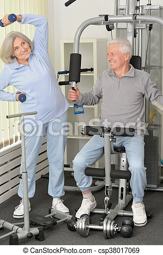 senior couple exercising in gym - csp38017069