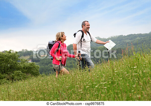 Senior couple hiking in natural landscape - csp9976875