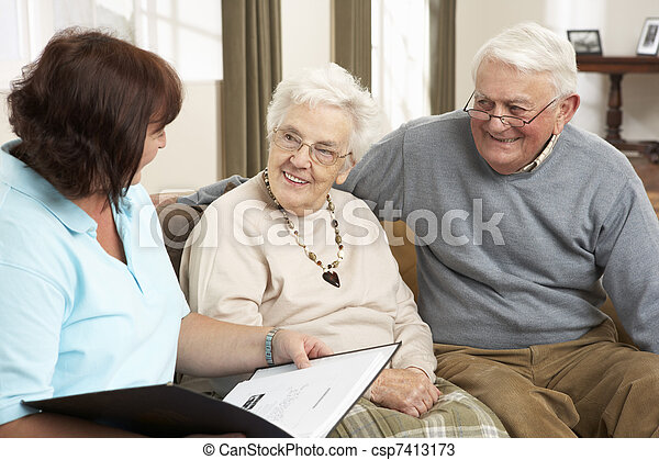 Senior Couple In Discussion With Health Visitor At Home - csp7413173