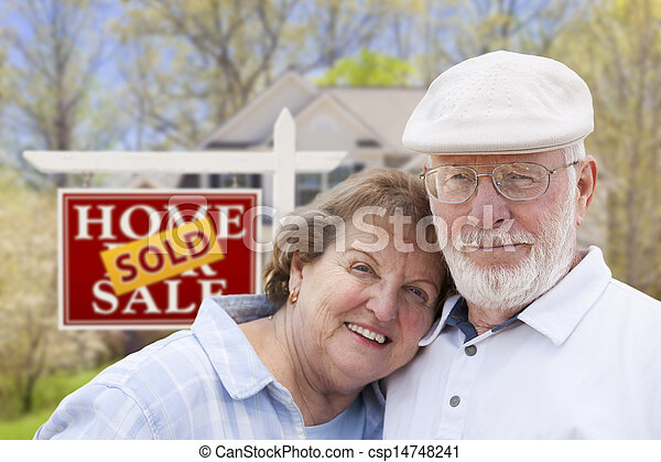 Senior Couple in Front of Sold Real Estate Sign and House - csp14748241