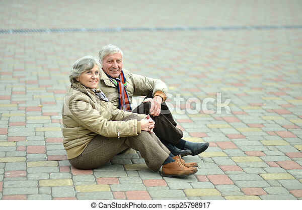 Senior couple in park  - csp25798917