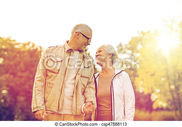 senior couple in park - csp47888113