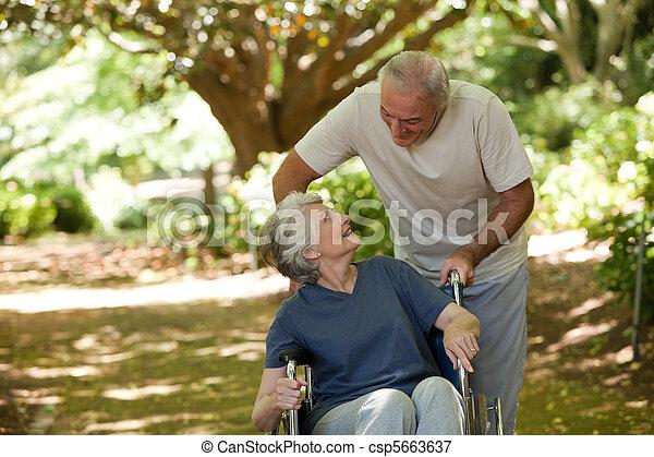 Senior couple in the woods - csp5663637