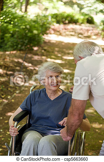 Senior couple in the woods - csp5663660