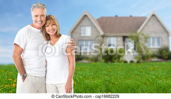 Senior couple near new home. - csp16682229
