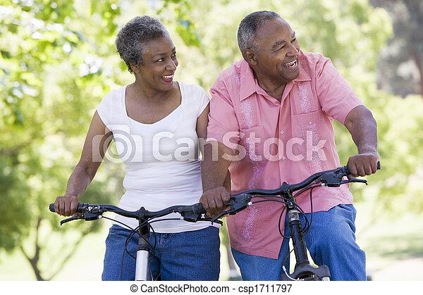 Senior couple on bicycles - csp1711797
