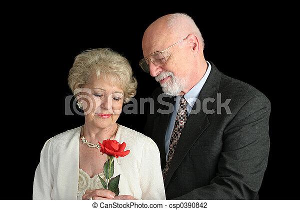 Senior Couple on Black - Romantic Gesture - csp0390842