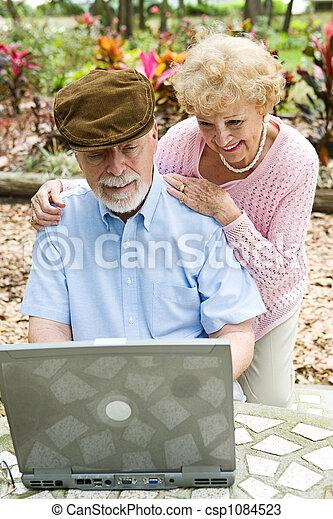 Senior Couple on Computer - Vertical - csp1084523