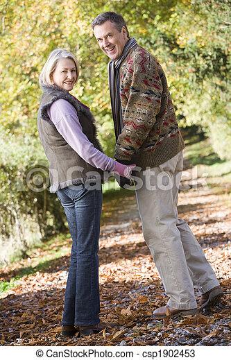 Senior couple on woodland walk - csp1902453