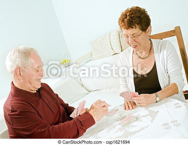 senior couple playing cards - csp1621694
