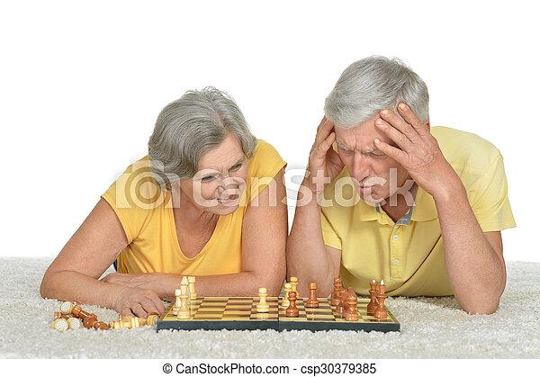 Senior couple playing chess - csp30379385
