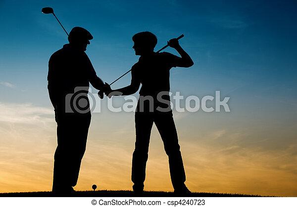 Senior couple playing Golf at sunse - csp4240723