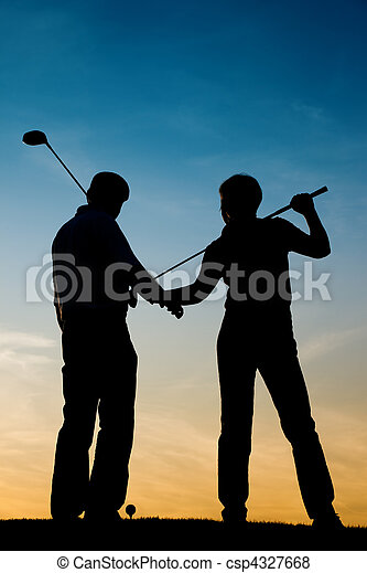 Senior couple playing Golf at sunset - csp4327668