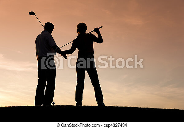 Senior couple playing Golf at sunset - csp4327434