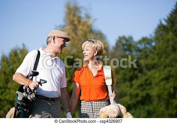 Senior couple playing Golf - csp4326907