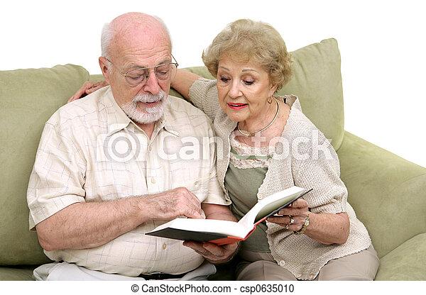 Senior Couple Reading Together - csp0635010