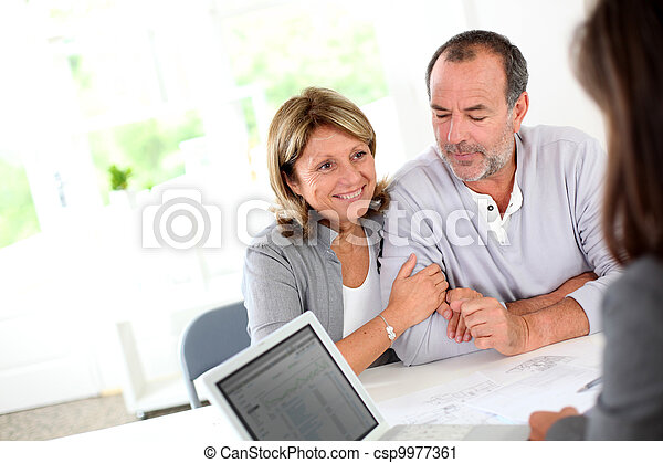 Senior couple ready to buy new house reading contract - csp9977361
