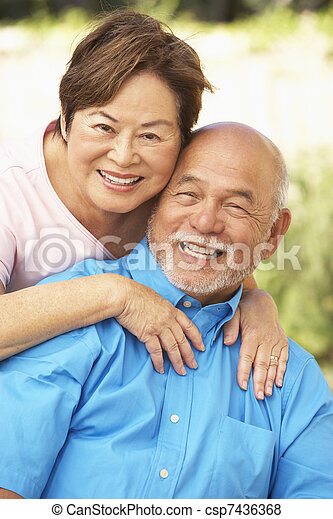 Senior Couple Relaxing In Garden Together - csp7436368