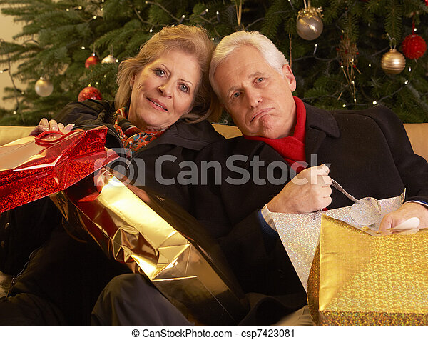 Senior Couple Returning After Christmas Shopping Trip - csp7423081