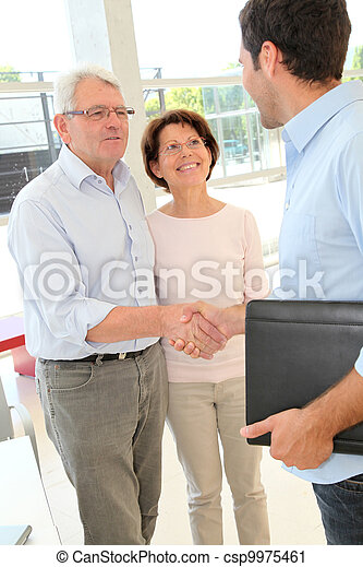 Senior couple signing contract - csp9975461