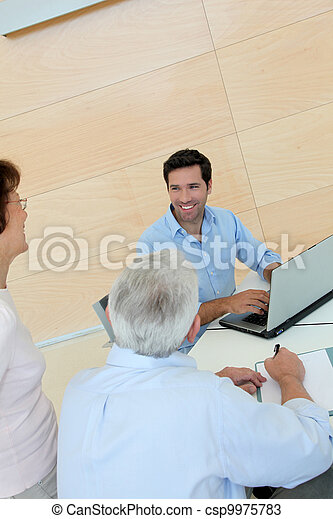 Senior couple signing contract - csp9975783