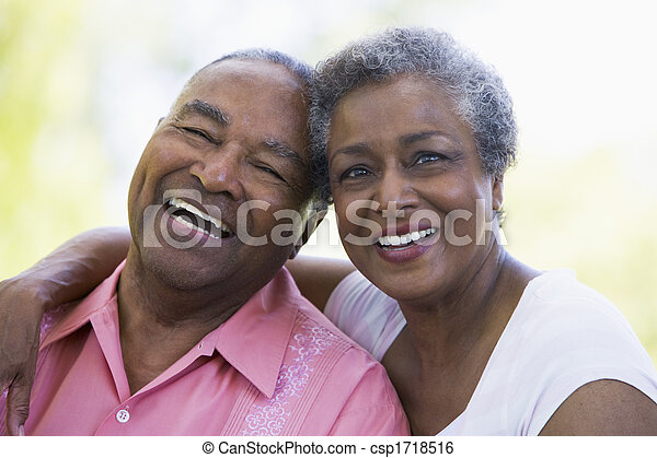 Senior couple sitting outdoors - csp1718516