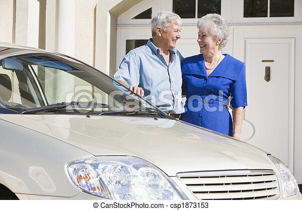 Senior couple standing next to car - csp1873153