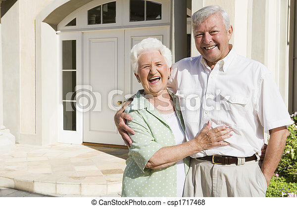 Senior couple standing outside their home - csp1717468