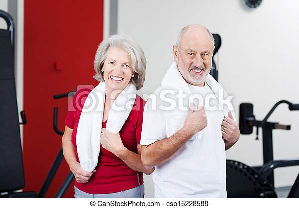 Senior Couple Standing Together In Gym - csp15228588