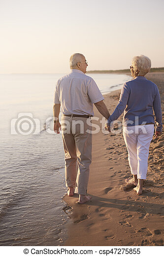 Senior couple walking hand by hand - csp47275855