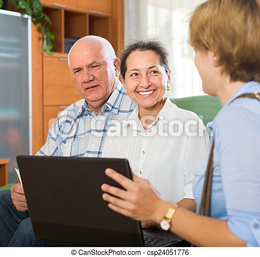 Senior couple with social worker at home - csp24051776