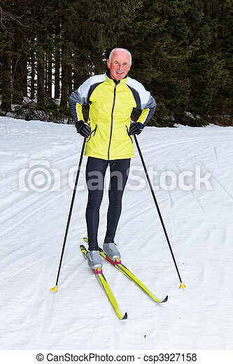 Senior cross country skiing during the winter - csp3927158