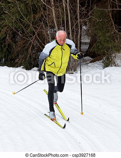 Senior cross country skiing during the winter - csp3927168