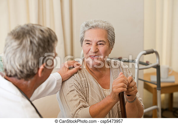 Senior doctor talking with his patient - csp5473957