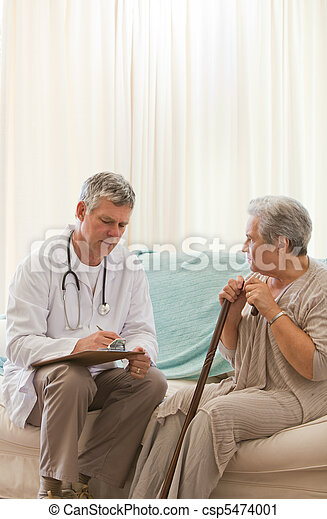Senior doctor talking with his patient - csp5474001