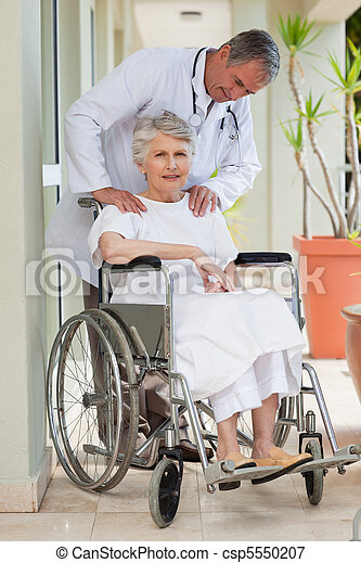 Senior doctor talking with his patient - csp5550207