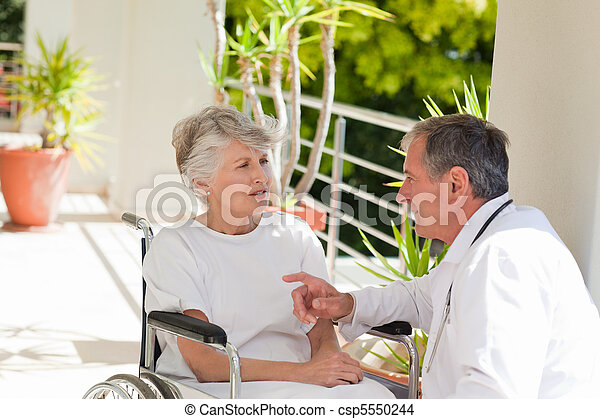 Senior doctor talking with his patient - csp5550244