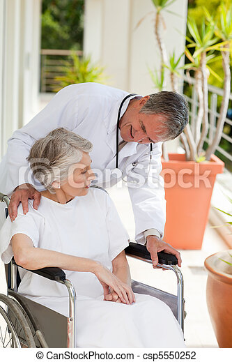 Senior doctor talking with his patient - csp5550252