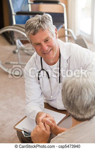 Senior doctor talking with his patient - csp5473940