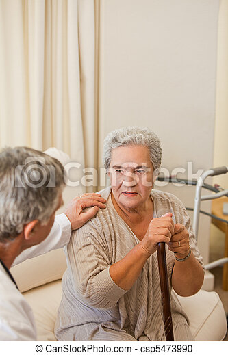 Senior doctor talking with his patient - csp5473990