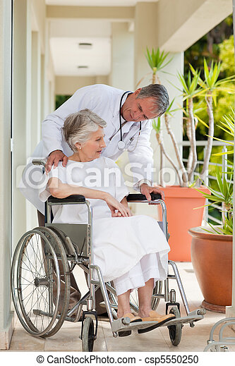 Senior doctor talking with his patient - csp5550250