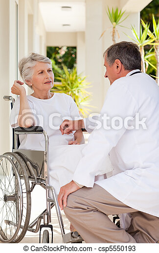 Senior doctor talking with his patient - csp5550193