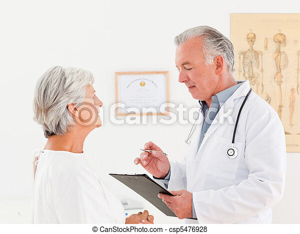 Senior doctor talking with his sick patient - csp5476928