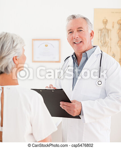 Senior doctor talking with his sick patient - csp5476802
