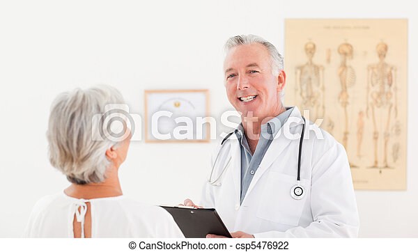 Senior doctor talking with his sick patient - csp5476922