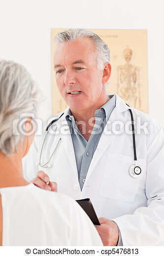 Senior doctor talking with his sick patient - csp5476813